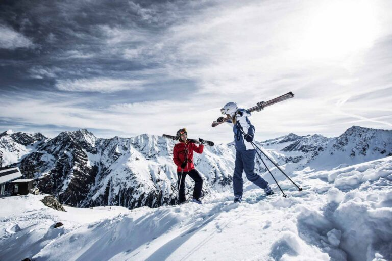 Two skiers at the Rifflsee